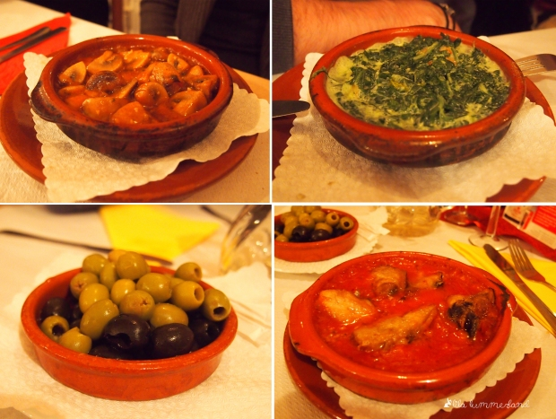 Tapas: Champignons, Scampis in Spinat, Oliven und Hähnchen in Tomatensauce
